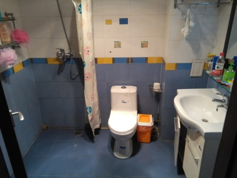 A typical chinese bathroom wet room tiled throughout