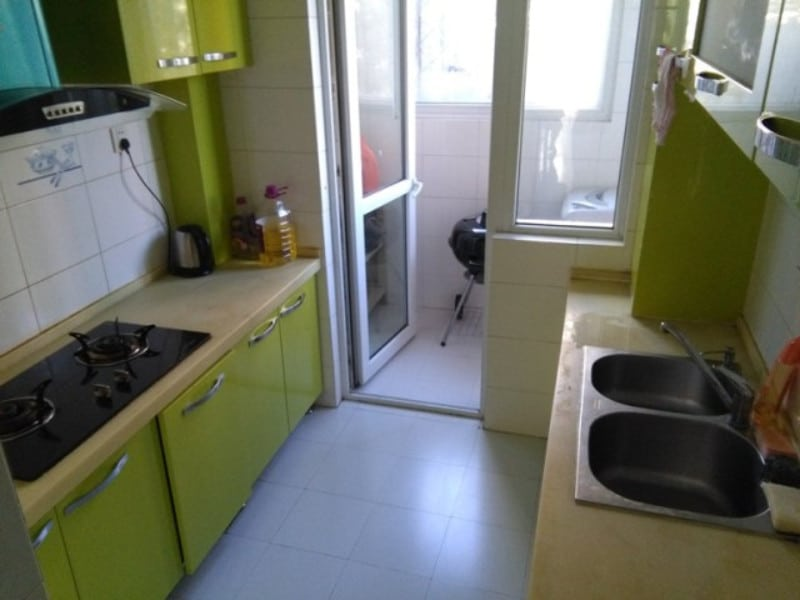 A lime green example of a typical chinese apartment kitchen