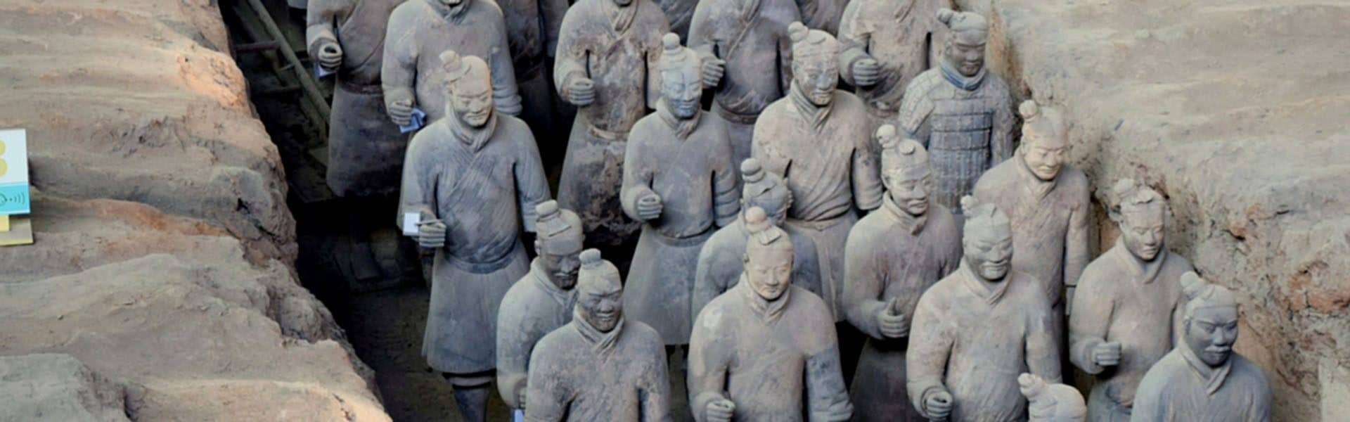Lines of terracotta soldiers in the trenches they were found in