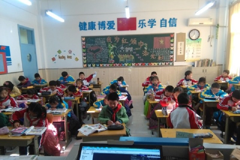 A classroom full of chinese pupils