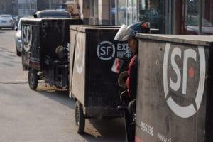 A line of delivery tuk tuks in Beijing
