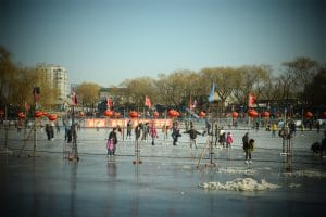 A large group of people skating on ice in Beijing