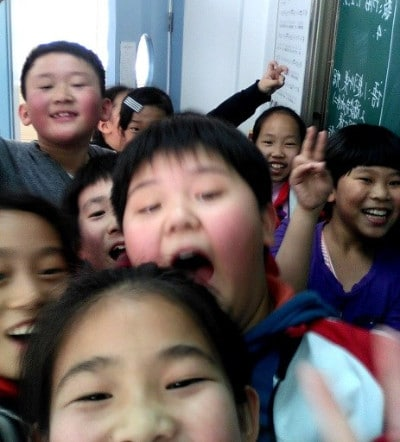 A group of chinese students going crazy in a photo