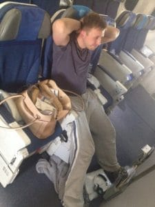 A man with extra leg room on a flight
