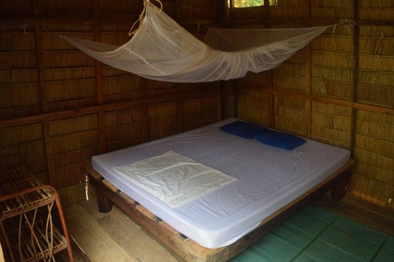 A double bed in a wooden bungalow on koh ta kiev island