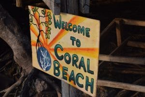 A colourful sign welcoming people to coral beach in koh ta kiev