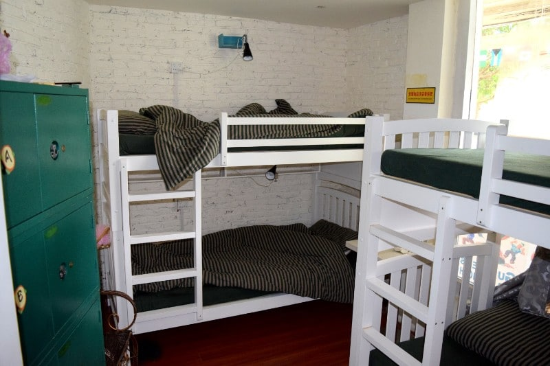 White bunk beds in a hostel room