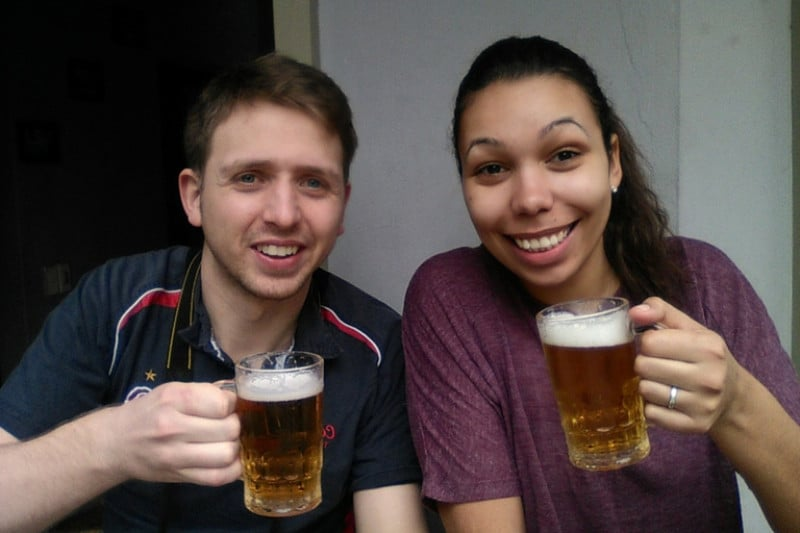 2 people drinking very cheap beer calld bia hoi in hanoi