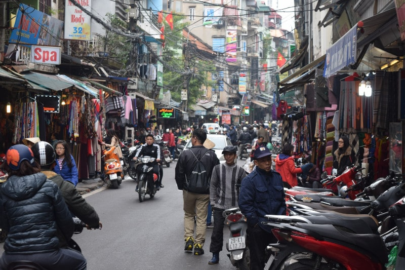 A busy street with people and motorbikes in Hanoi Vietnam