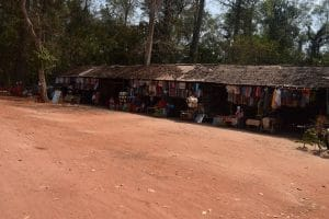 A collection of stalls on red dirt