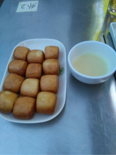 Dough balls deep fried and served with condensed milk