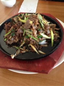Many pieces of pork with spring onion shallow fried