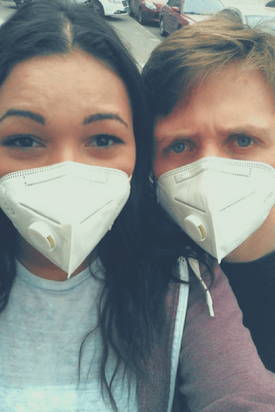 Two people wearing masks in beijing