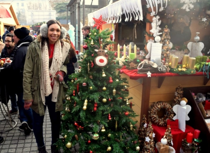 A lady stood next to a christmas tree in Beijing