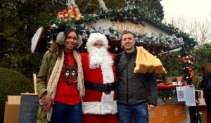""" people either side of santa claus in beijing China"