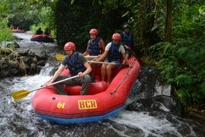 A white water rafting boat in bali with 4 people in