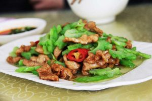 Chinese food on a white square plate