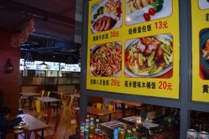 Yellow sign with 4 different Chinese meals on