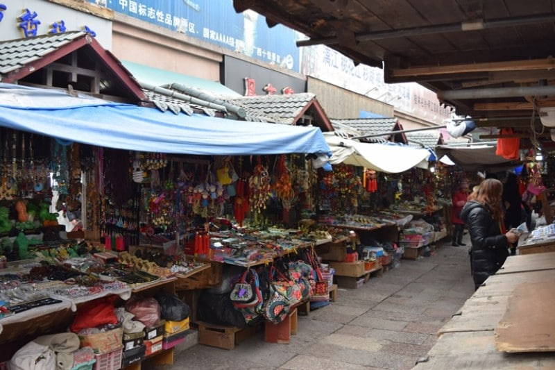 Brightly coloured souvenirs under market canopy