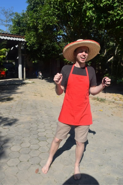 A man wearing a sombrero at a cooking school in chiang mai thailand