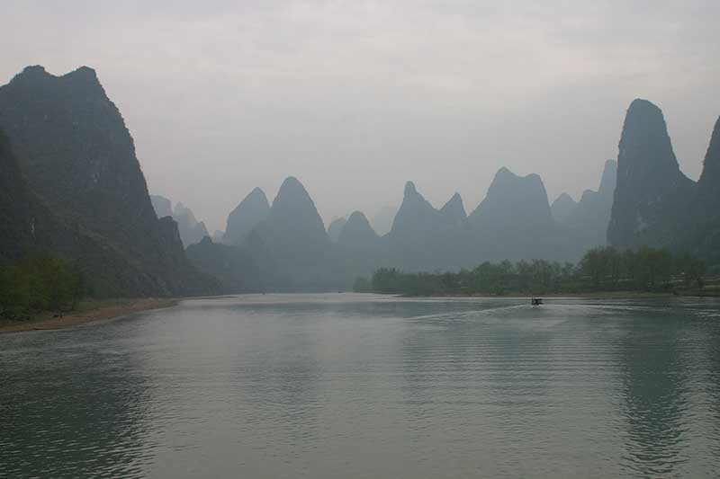 The Li river covered in mist in the mountains