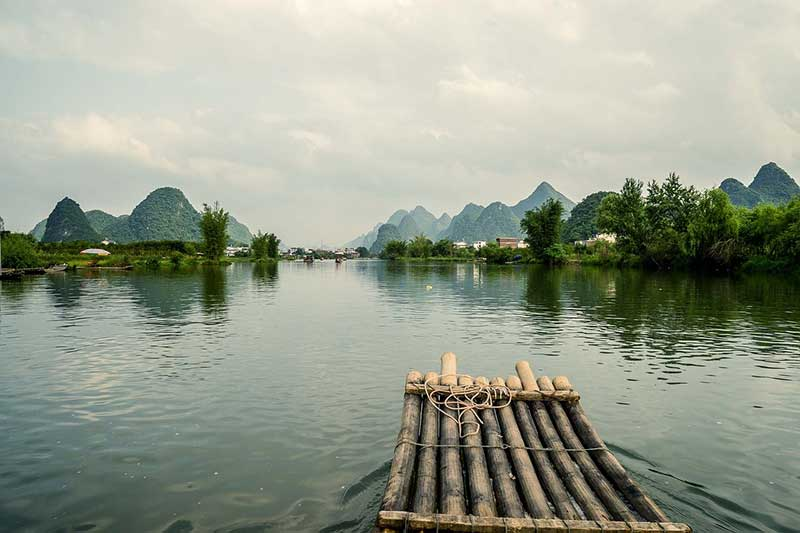 The li river in China with hills covering the landscape. one of the best things to do in Guilin