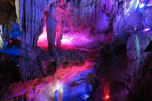 A colourful pruple cave system in Guilin China, one of the best things to do in Guilin