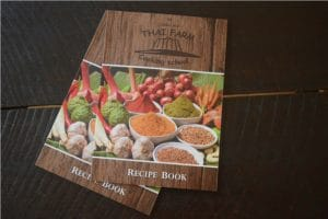 2 recipe booklets given to us by thai farm cooking school chiang mai