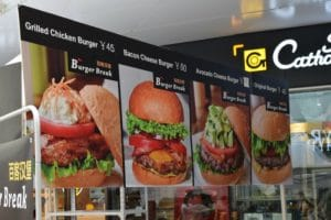 A sign showing 4 different burgers