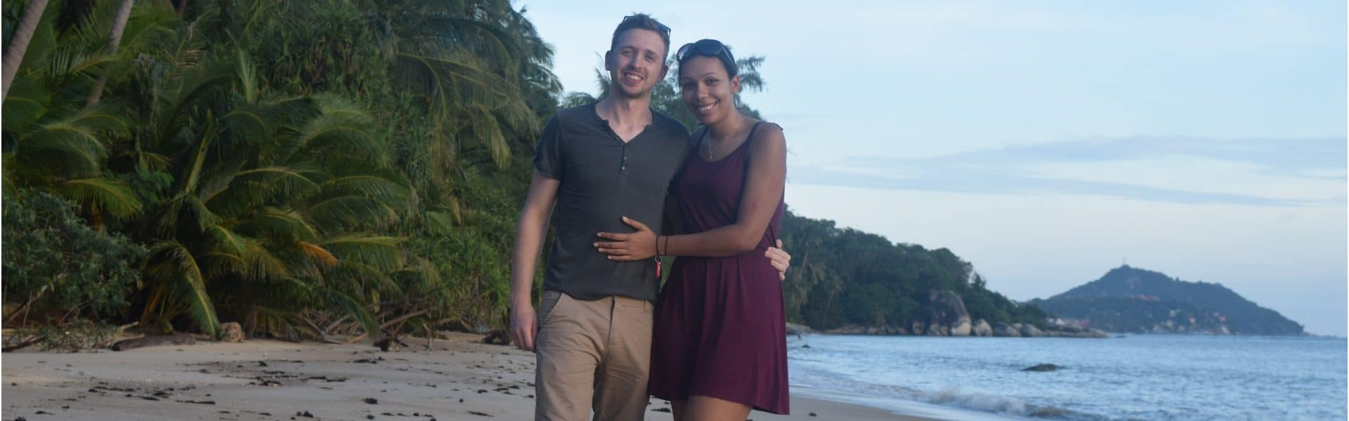 A man and a woman standing together on a beach