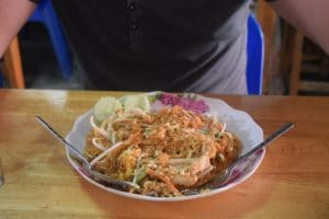 A famous thai dish that is served with noodles peanuts and other thai seasonings
