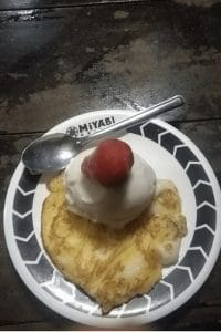 A pancake with some ice cream on top