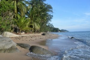 A rocky and sandy beach on koh phangan thailand