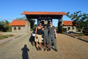 2 tall people at yala national park sri lankan safari with their guide in the middle