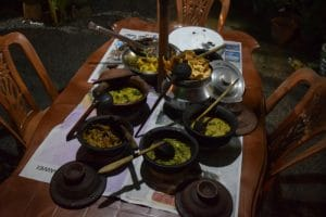 A large collection of metal pots containing sri lankan curry dishes