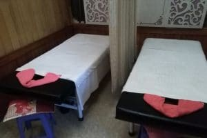2 massage tables with white towels on
