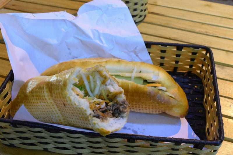 Bread roll with meat and salad in - typical Vietnamese baguette