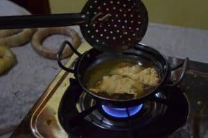 A poppadom in oil being deep fried