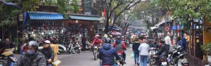 Busy street view with motorcycles and pedestrians - Things to do backpacking Vietnam on a Budget