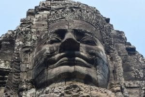 A very large stone face in angkor wat cambodia