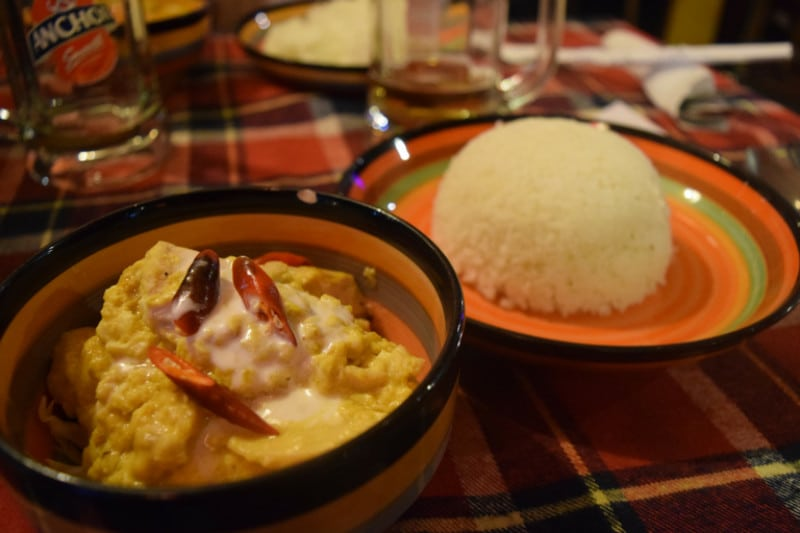 A typical cambodian rice and curry dish on a tartan cloth