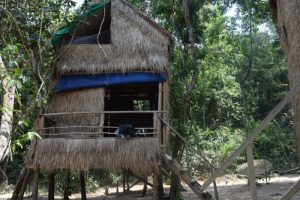 A two story wooden bungalow on the beach in koh ta kiev