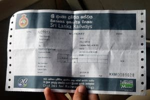 A large paper ticket for a sri lankan train journey
