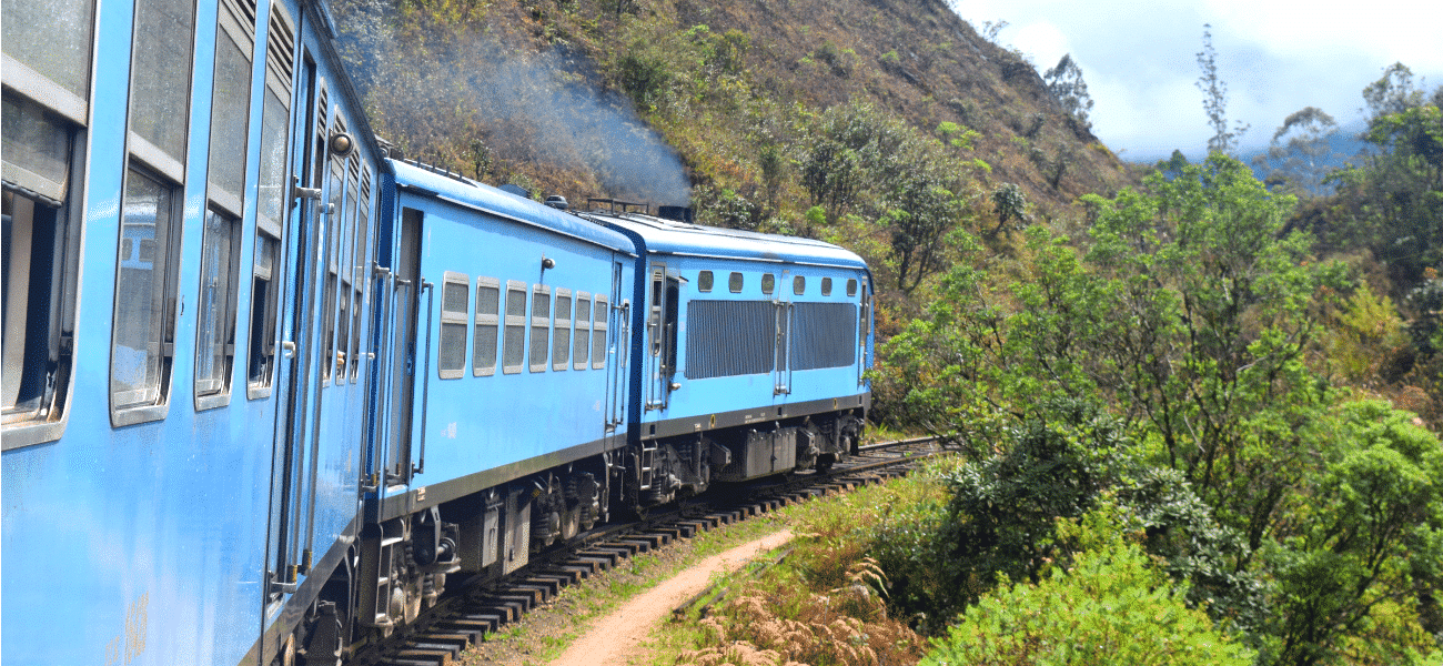 Blue Train From Kandy To Ella Taking A Corner On A 10 Day Sri Lanka Itinerary