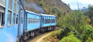 Blue Train From Kandy To Ella Taking A Corner On A 10 Day Sri Lanka Itinerary