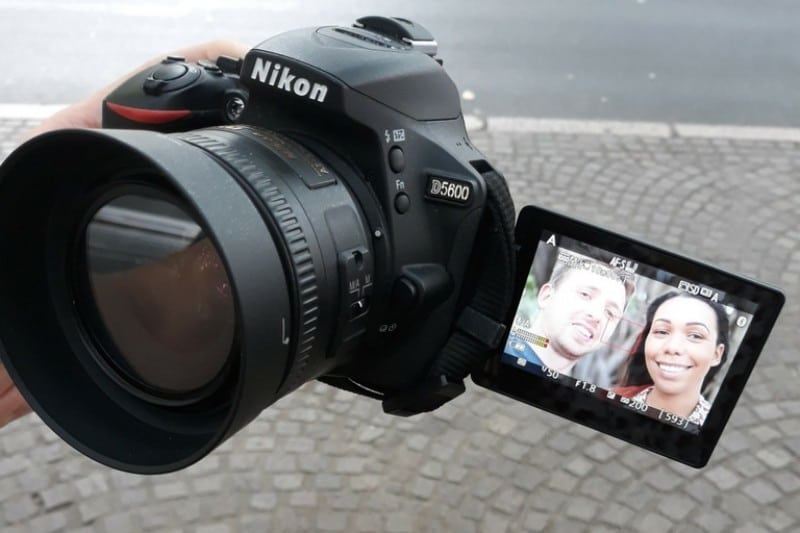 Nikon 5600 with extendable screen and a photo of a woman and a man on it