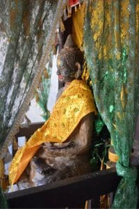 A statue wrapped in golden cloth at angkor wat