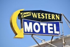 A yellow, blue and black sign saying Great Western Motel
