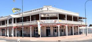 A large 2 storey pub with a verandah