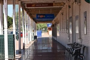 The view looking ahead underneath the verandah with a blue Keno sign